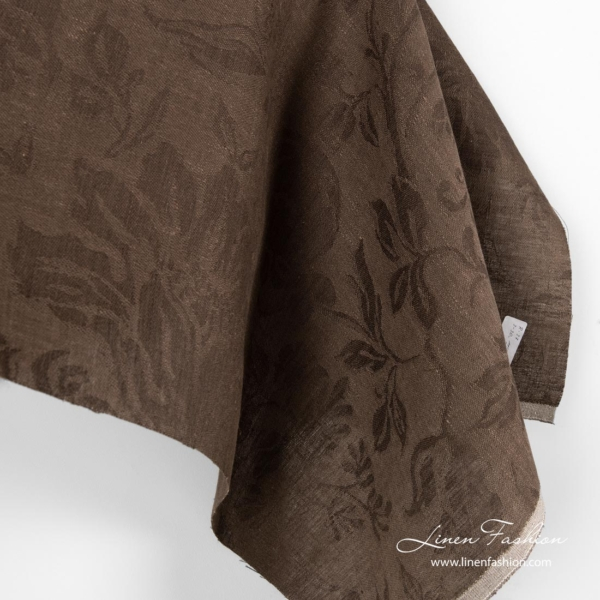 Brown linen fabric with flowers and leaves