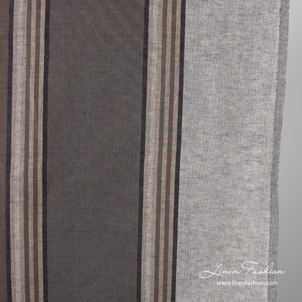 Close view of striped brown grey colored linen fabric
