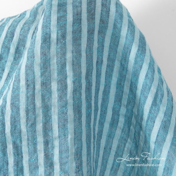Washed linen fabric in sky blue stripes