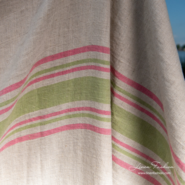 Grey beach towel with green and pink stripes