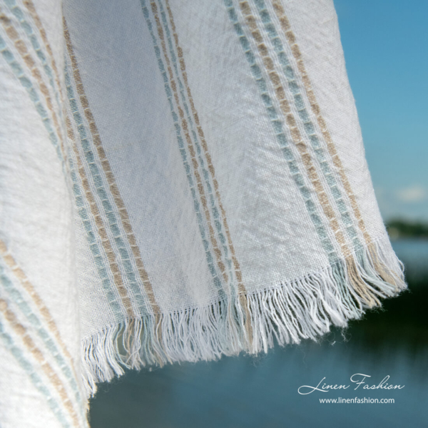 White beach towel with multi color stripes