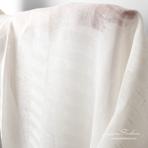 Sheer white linen fabric in wide stripes