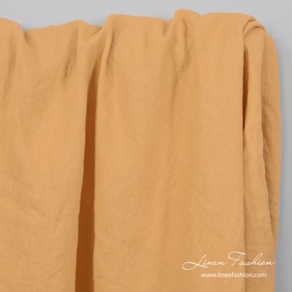 Peach yellow color linen fabric, washed