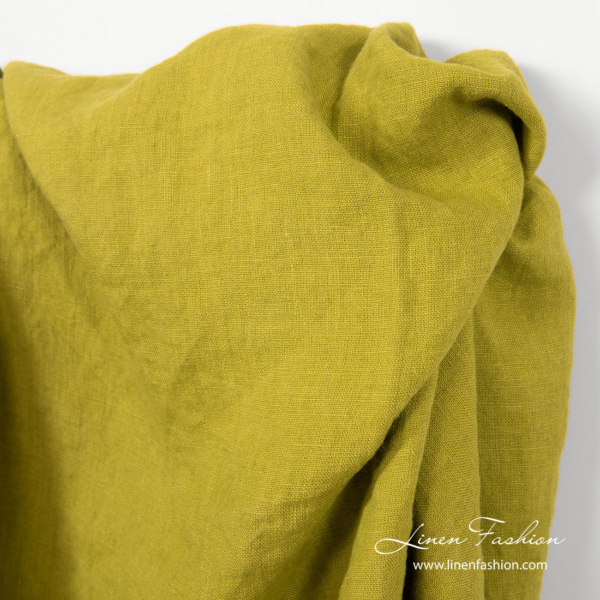 Plain weave, salad green linen fabric, washed