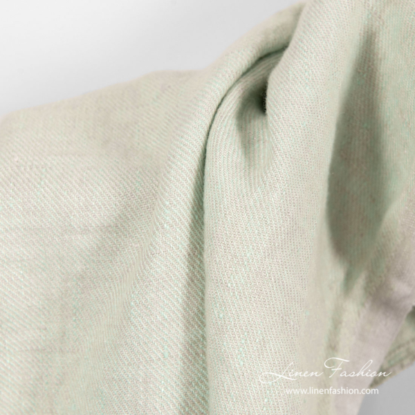 Washed twill weave linen fabric in faded green color