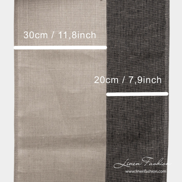 Natural and black stripe measures on narrow linen fabric
