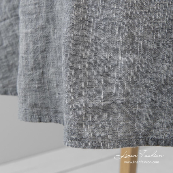 Simple hemmed round tablecloth in dark grey and white melange colors