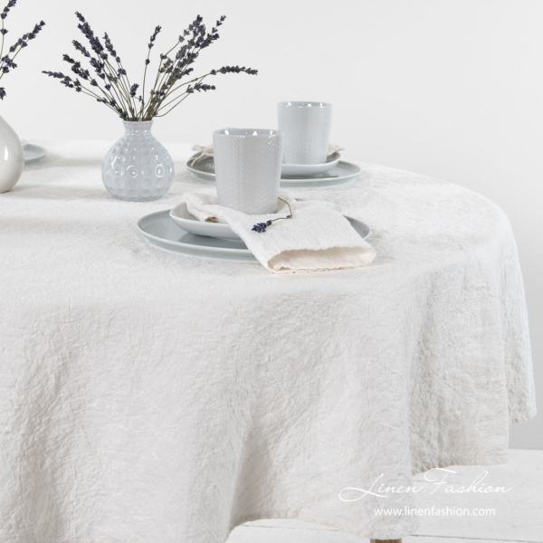 Round off white linen cotton tablecloth, washed