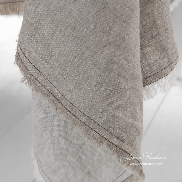 Washed linen tablecloth with white and grey fringes