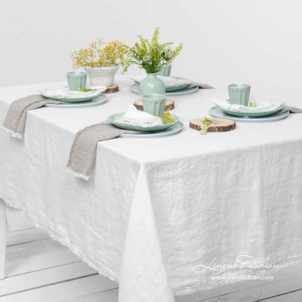 Off white linen tablecloth with loose fringes, washed