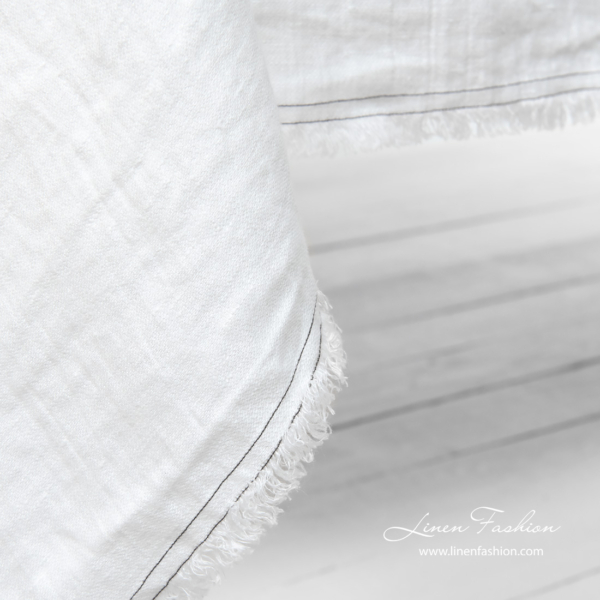 White tablecloth with fringes and double stitches