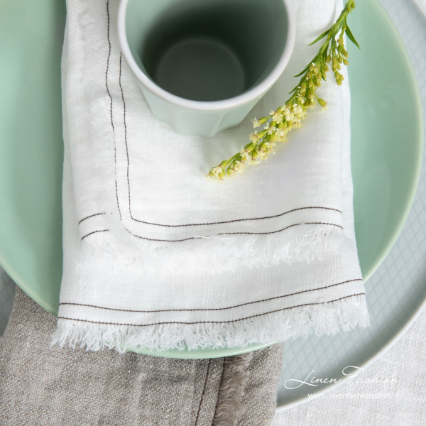 Washed white linen napkin with fringes and double stitch