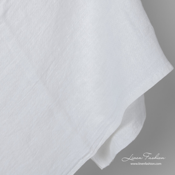 Washed bright white linen fabric in small squares