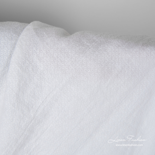 Snow white linen fabric with small square pattern, washed