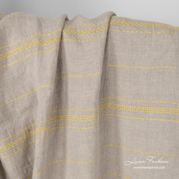 Washed flax color linen fabric with horizontal yellow stitches