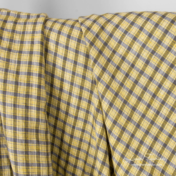 Washed, yellow and grey checked linen fabric