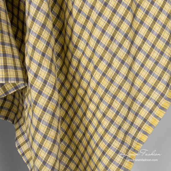 Linen fabric in grey crossing lines and yellow checks
