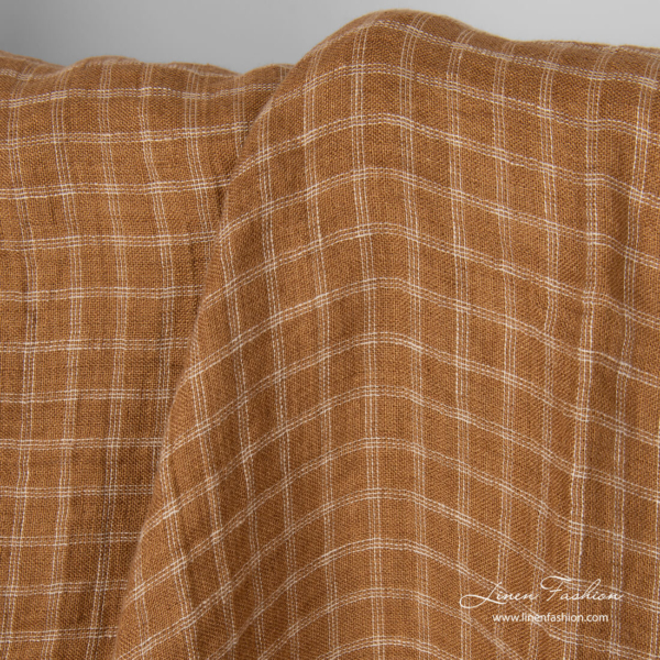 Washed cinnamon brown an light sand checked linen fabric