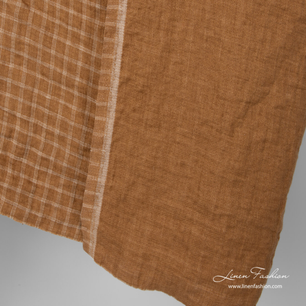 Washed linen fabric, one side is solid brown, other side is in light checks