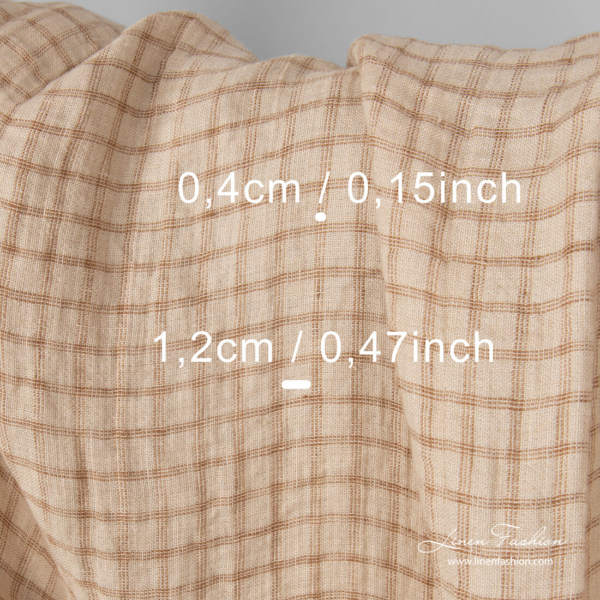 Check measures on washed linen fabric in sand colour