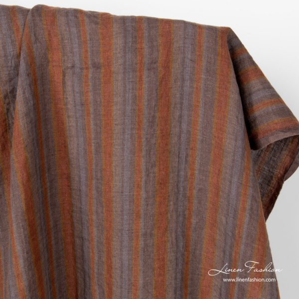 Linen fabric in brown grey vertical stripes, washed