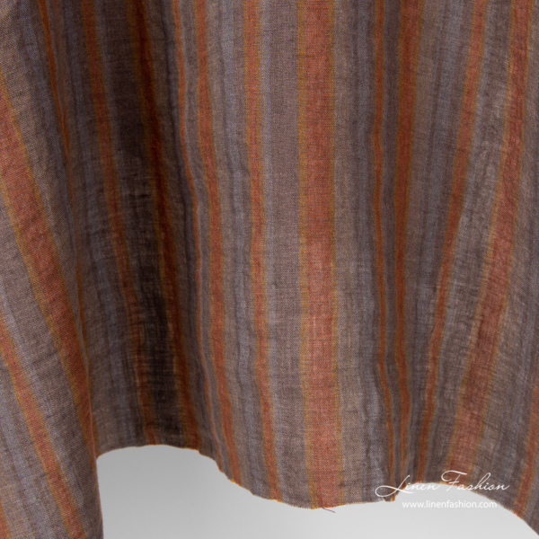 Variable brown and grey stripe width linen fabric, washed