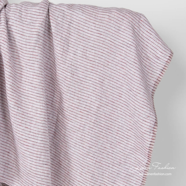 Washed light grey linen fabric with red lines and black dashes