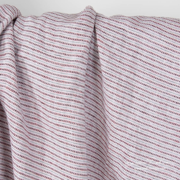 Light grey linen fabric with black small dashes and red lines, washed