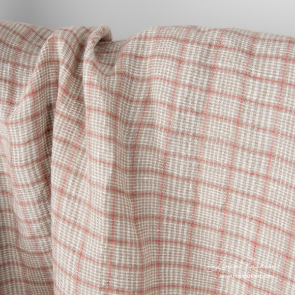 Washed linen fabric in grey squares framed in red and white checks inside it, washed
