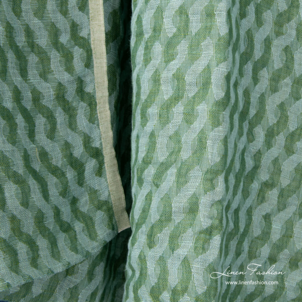 Washed linen fabric in green entwined waves