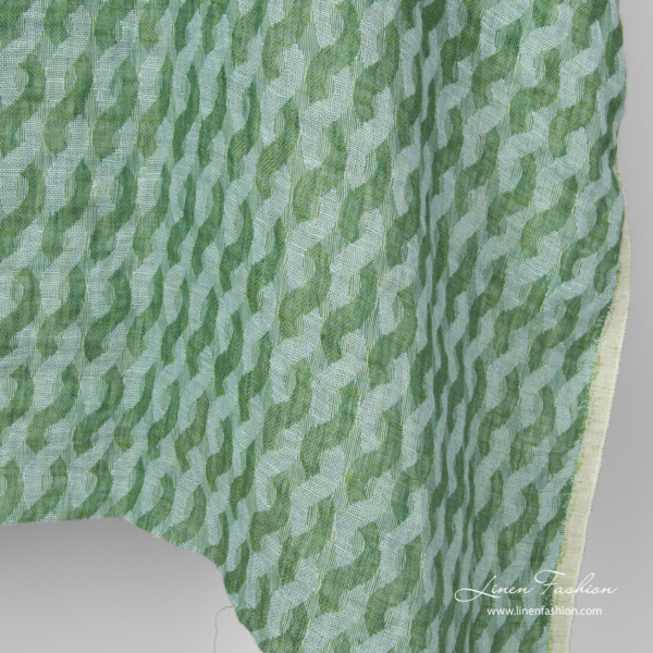 Washed green linen fabric in wave pattern