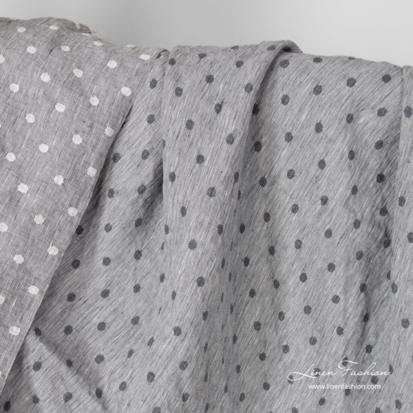 Light grey linen fabric with white/grey spots, washed