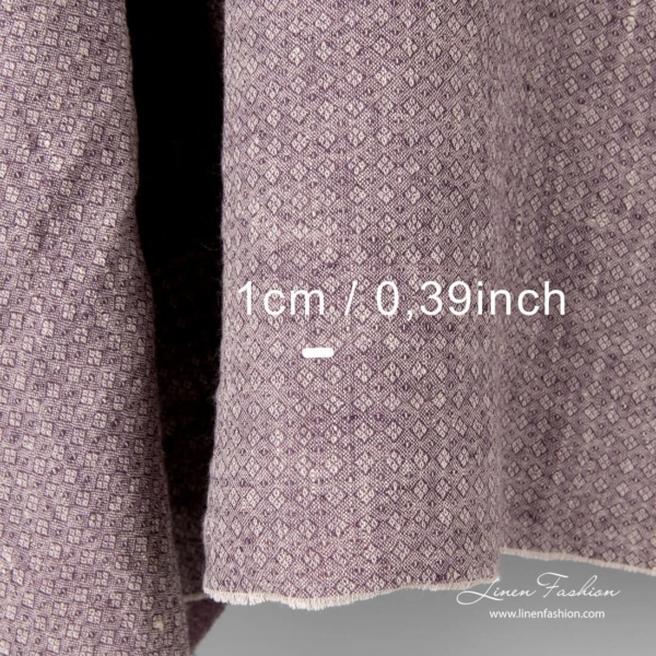 Washed purple linen fabric in small diamond pattern with measurements