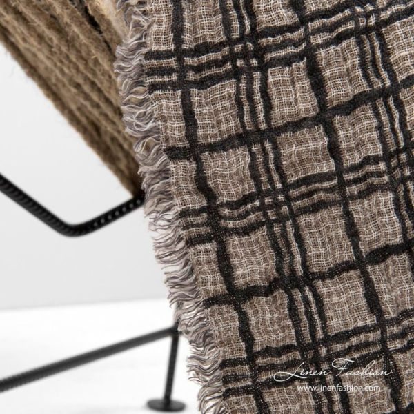Linen blanket with fringes, sand colour side with dark grey grids