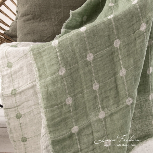 Green linen blanket with large checks and big dots