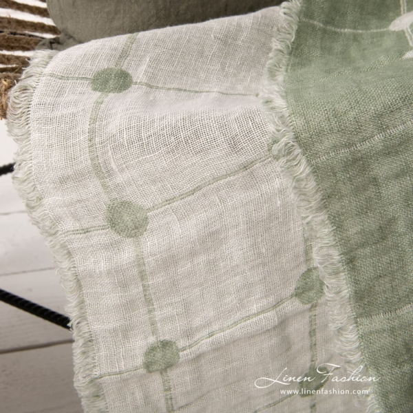 Green white reversible linen blanket with large dots and fringed edges