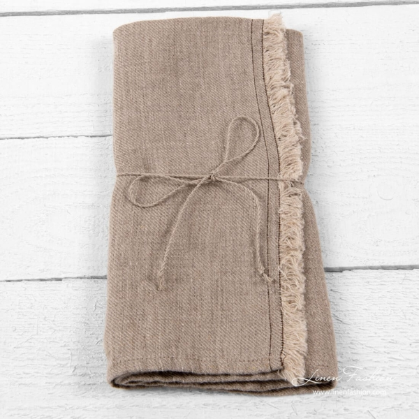 Linen kitchen towel with fringes and brown stitches