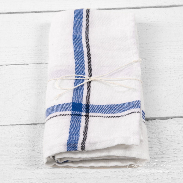 Bright white linen kitchen towel with blue and black checks