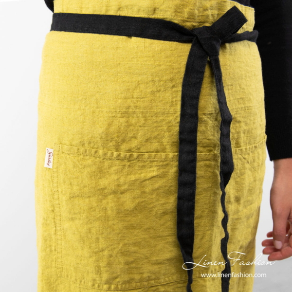 Linen apron in warm olive color and black ties