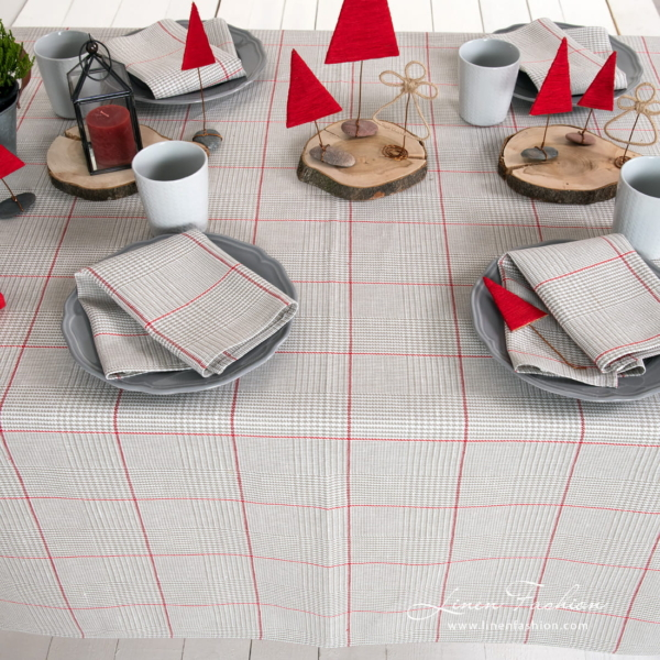 Grey checked tablecloth with red squares and matching napkins