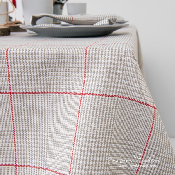 Large red squares on grey checked tablecloth