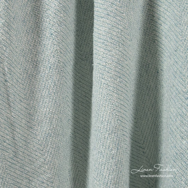 Greenish blue linen cotton fabric in herringbone pattern