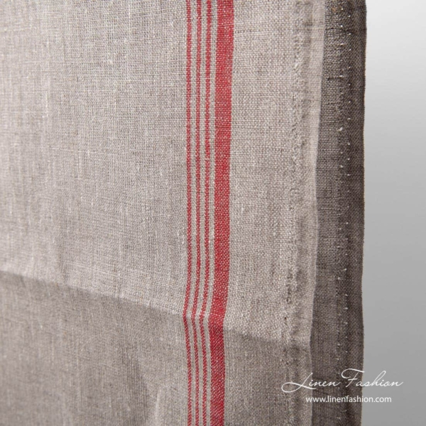 Narrow grey linen fabric with red stripe on one side