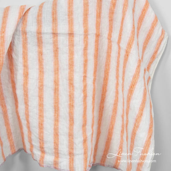 Washed linen fabric in orange stripes