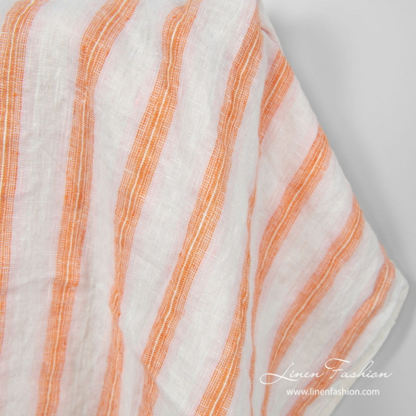 Linen fabric in off white, orange and light pink stripes, washed