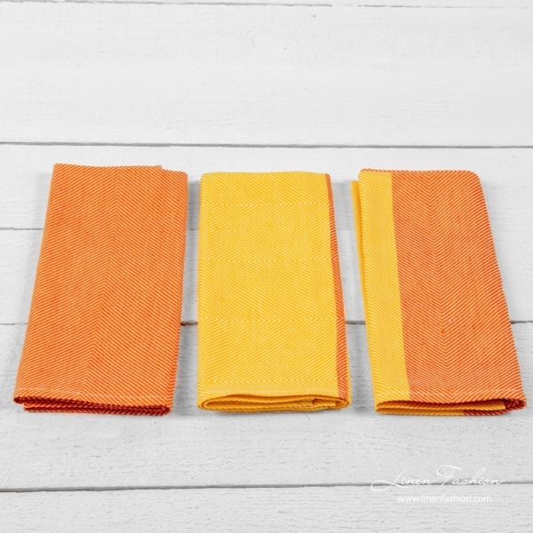 Set of kitchen towels colored in orange.