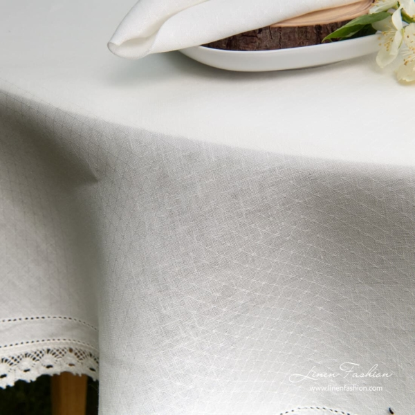 NORA linen round tablecloth, white colored.