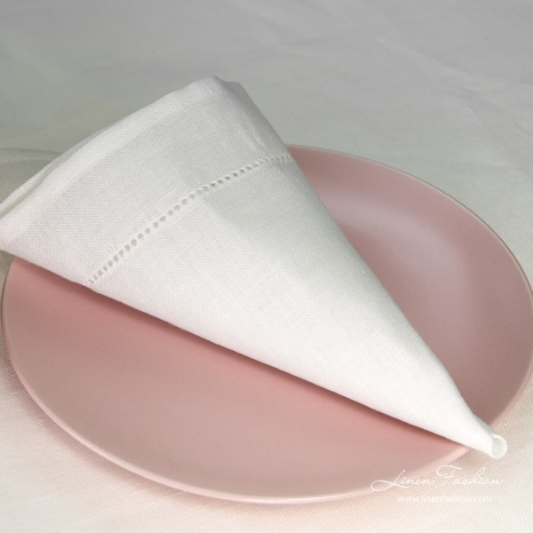 White napkin in hole pattern.