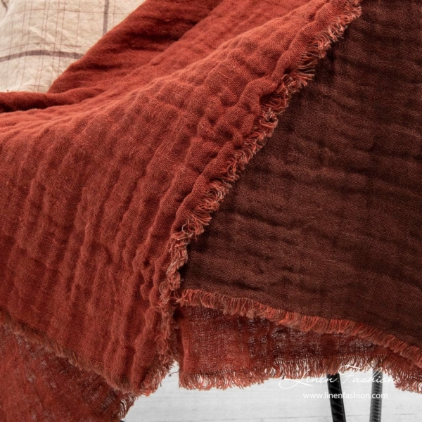 100% linen blanket colored in red and brown.