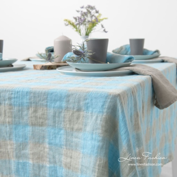 Sky blue and grey colored tablecloth, linen.